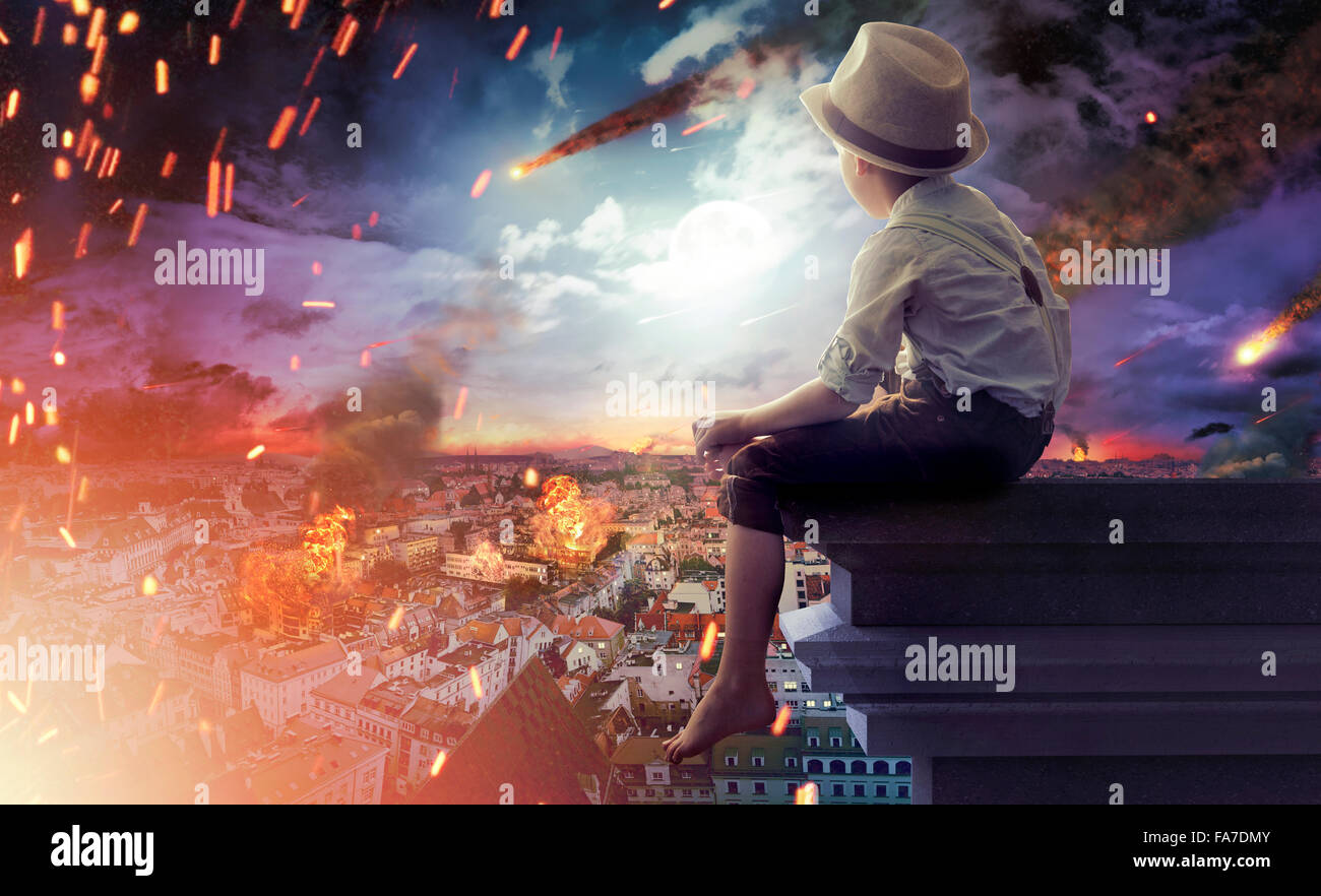 Little boy watching an end of the world - Stock Image