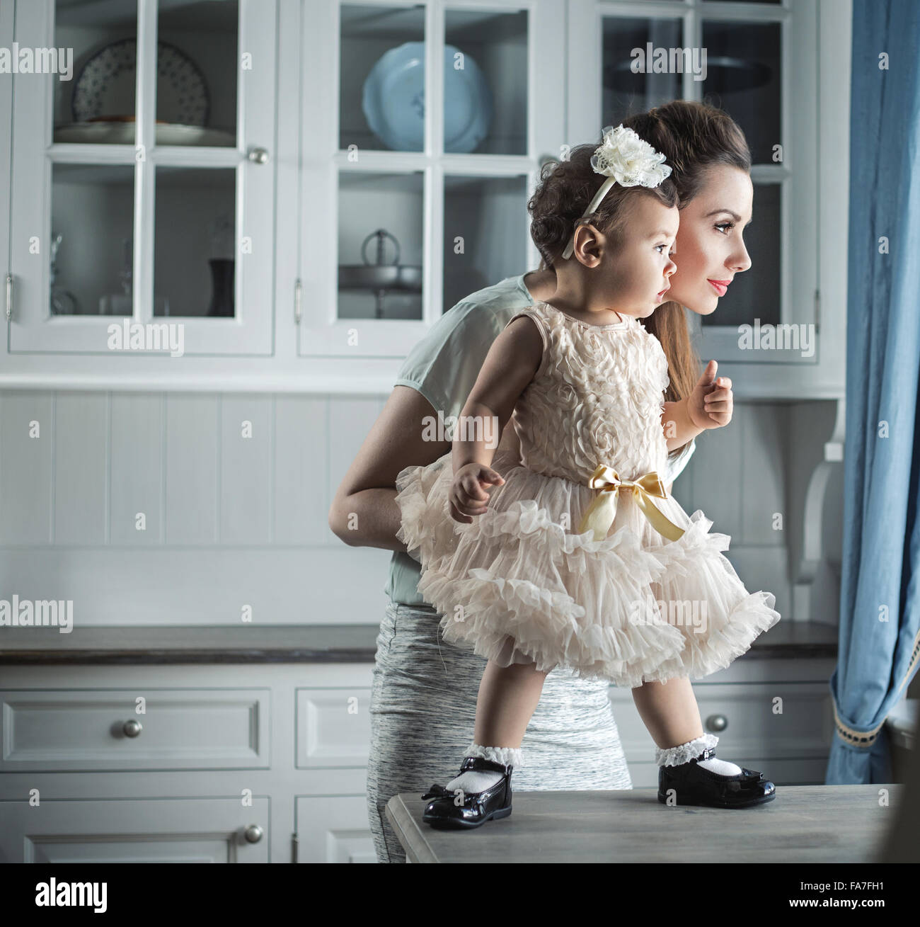 Pretty mom holding her lovely baby - Stock Image