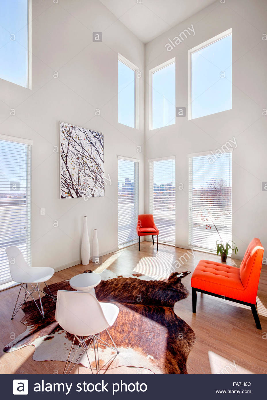 Interior view of an open and airy living room designed by Meridian ...