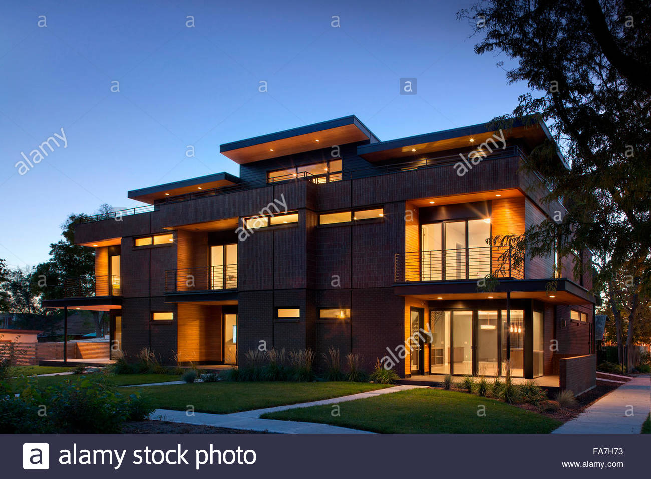 Modern red brick apartment building at dusk, Marion house designed by Sexton Lawton. - Stock Image
