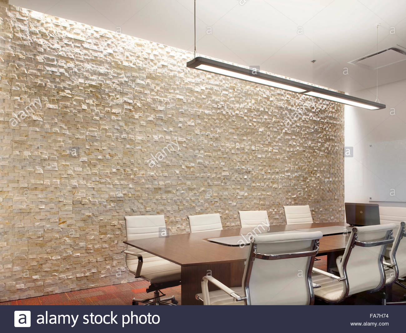 Office Conference Room With Creative Lighting Designed By Pinnacle Lighting.  A Feature Textured Wall,