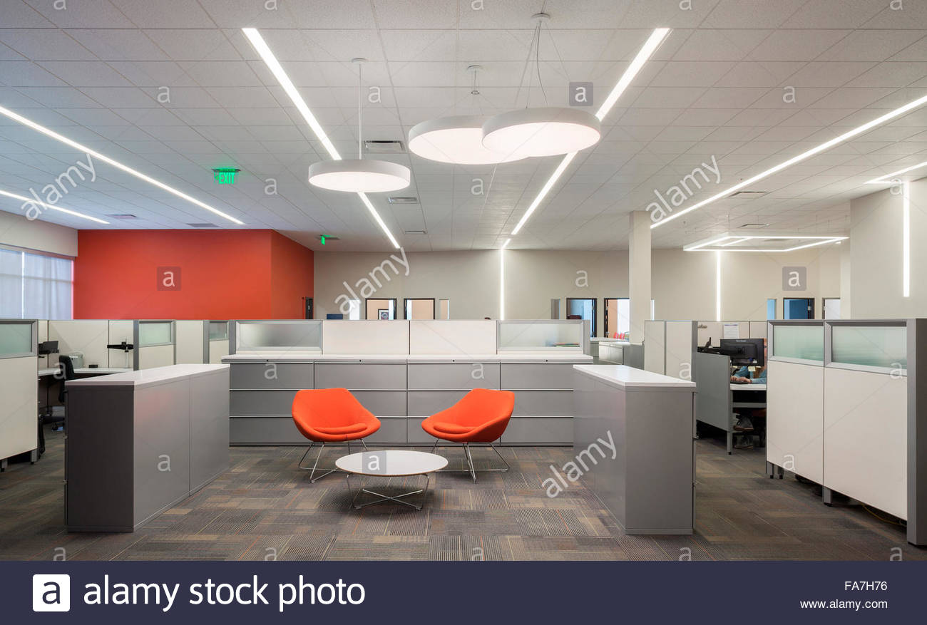 office space lighting. An Open Office Space With Creative Lighting. A Lobby, Chairs, Desks And Cubicle Walls. Large White Suspended Lights. Lighting Alamy