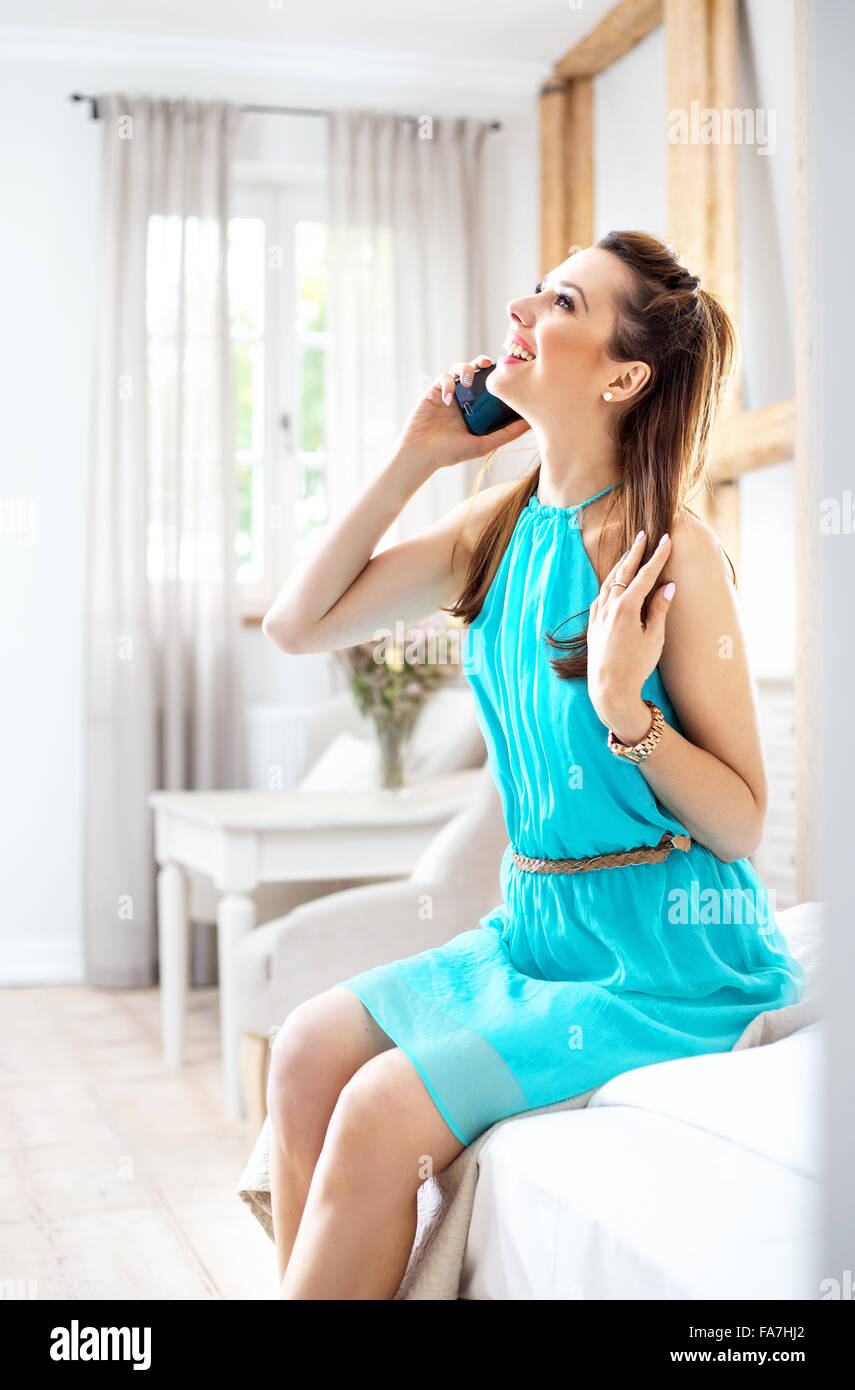 Pretty brunette talking on the smartphone - Stock Image