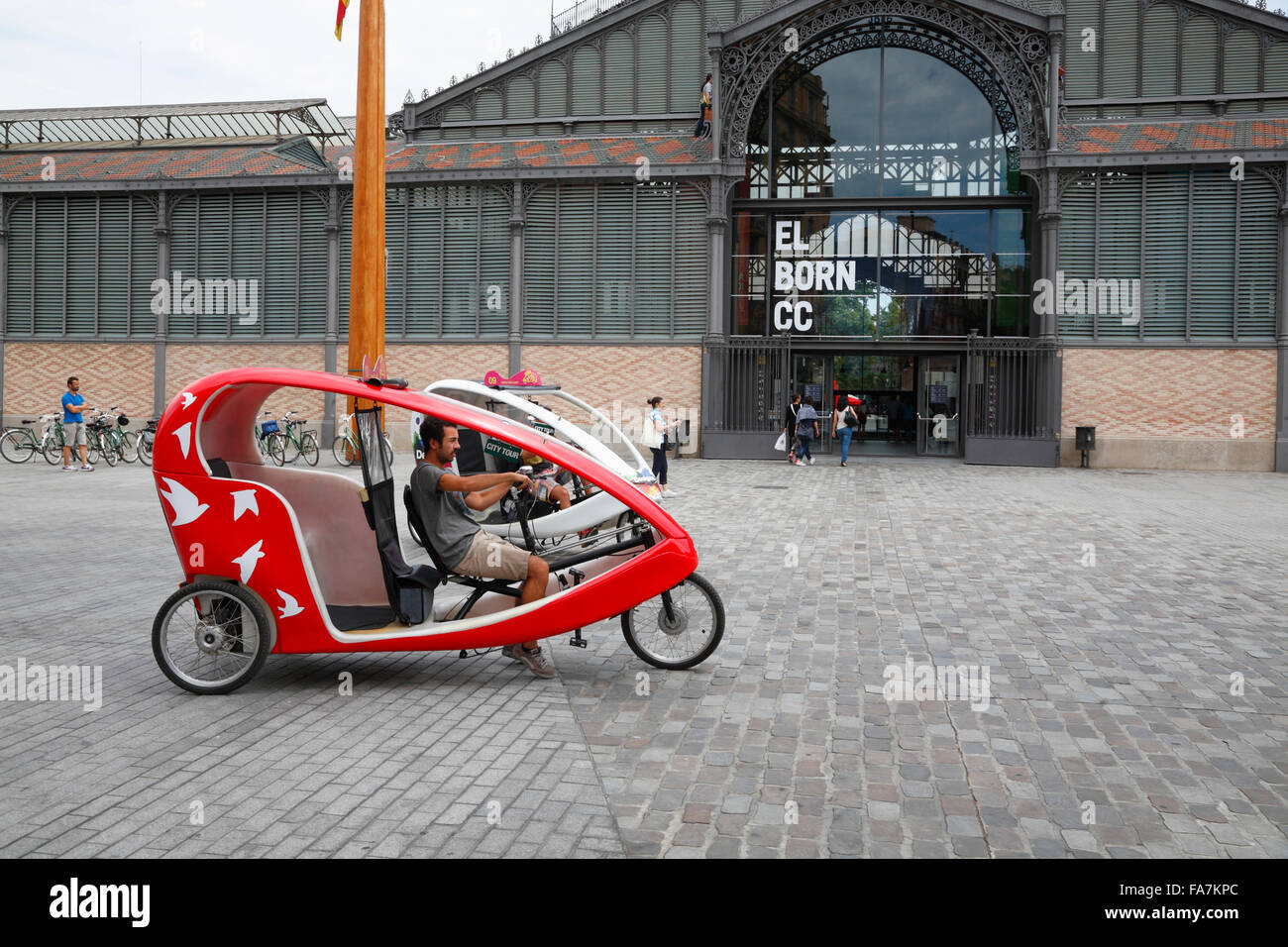 El Born, Rickshaw in front of the old market hall El Born, now Cultural Centre (CC), Barcelona, Spain, Europe - Stock Image