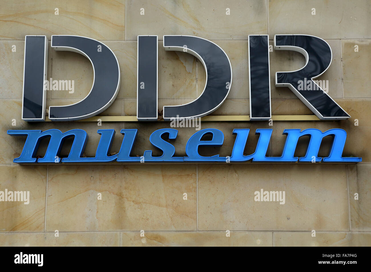 A sign for the DDR Museum in Berlin, Germany. The interactive museum conveys how life was in the German Democratic - Stock Image