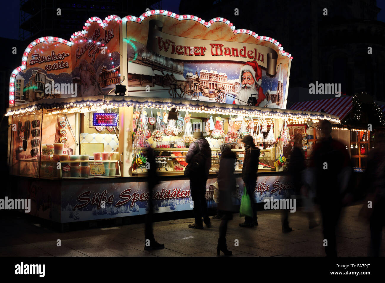 A sweets and nuts stall at the City Weihnachtsmarkt am Gedachtniskirche Christmas market on Ku'damm in Berlin, Germany. Stock Photo