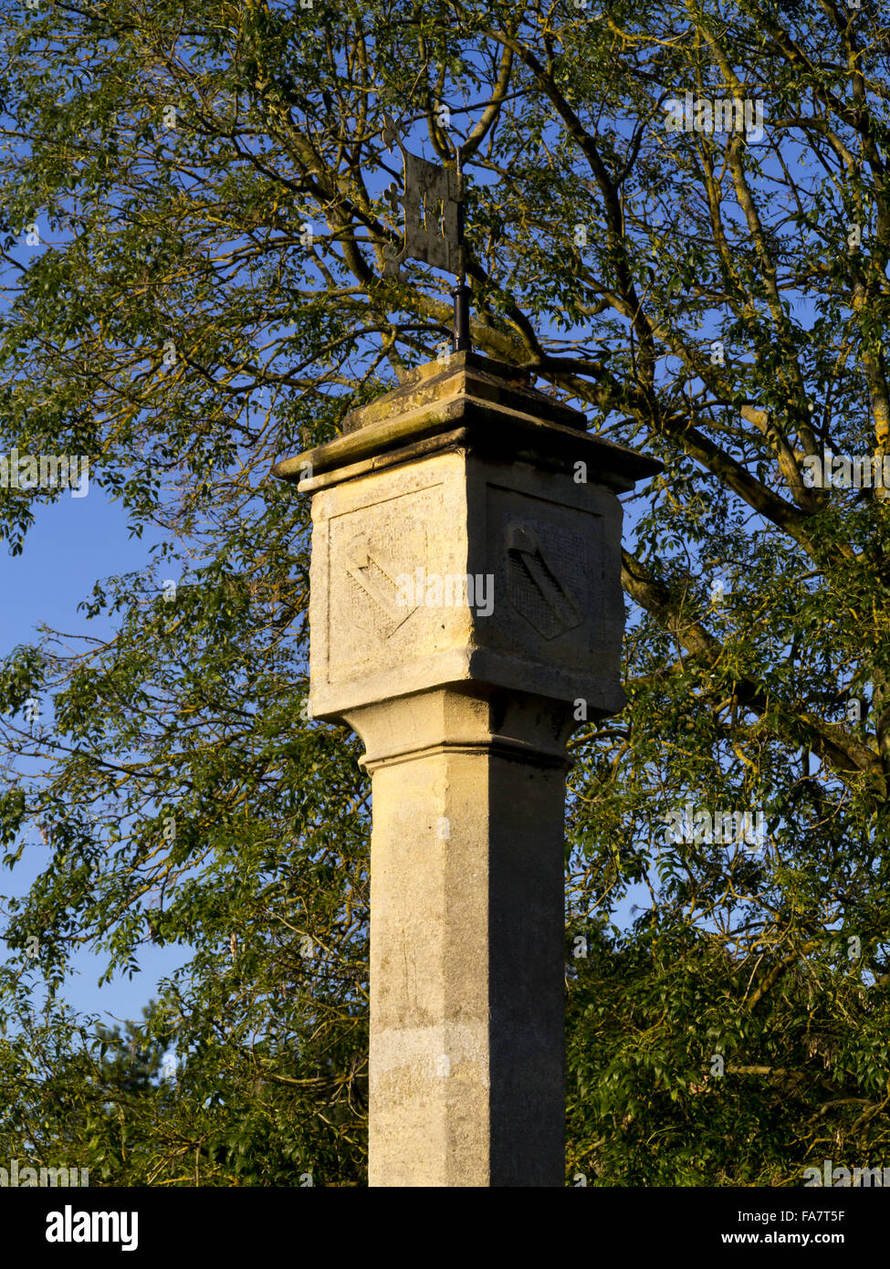 The sundial clock tower on the green at Blaise Hamlet in Bristol. The nine cottages around the green at Blaise Hamlet Stock Photo