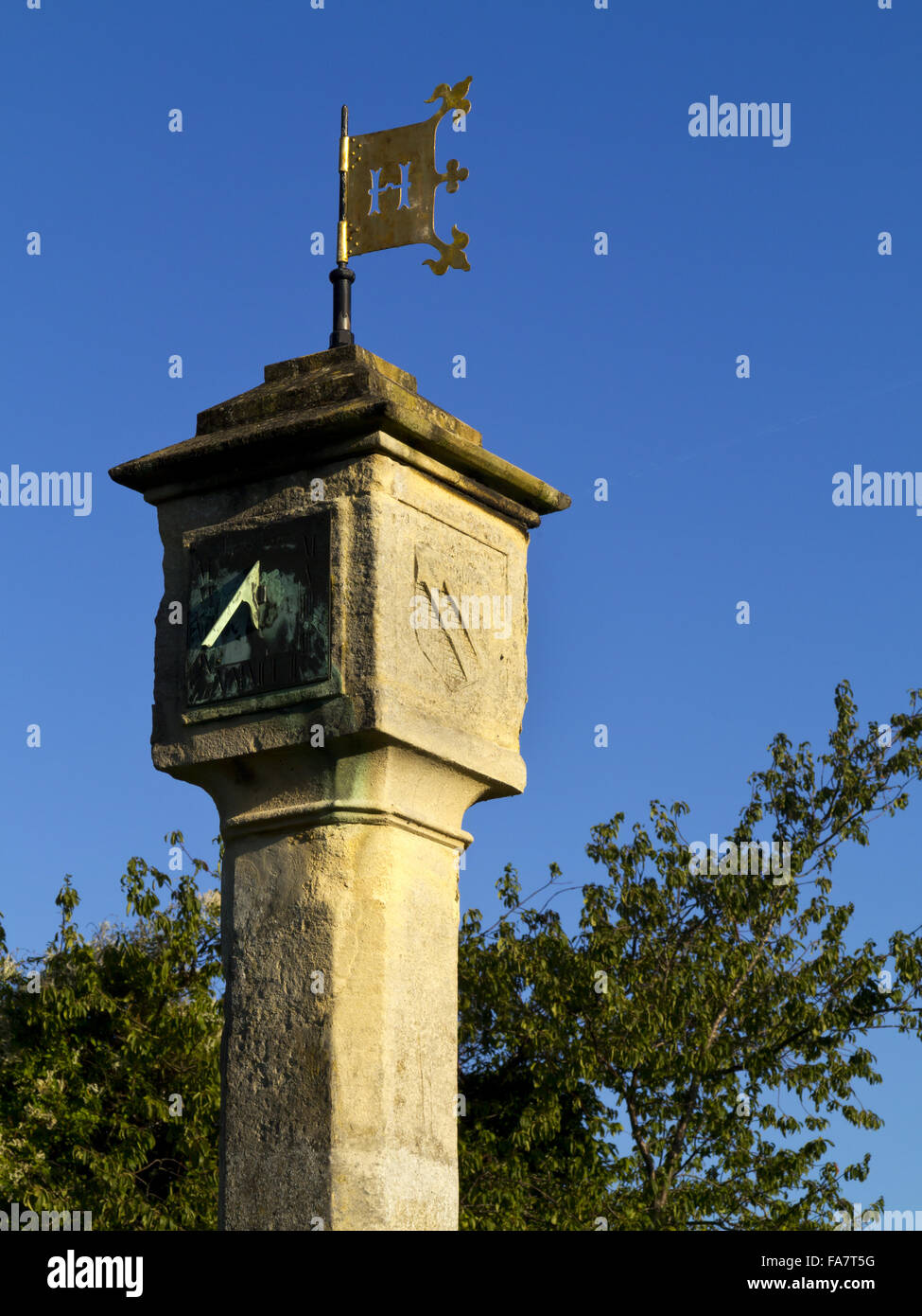 The sundial clock tower on the green at Blaise Hamlet in Bristol. The nine cottages around the green at Blaise Hamlet - Stock Image