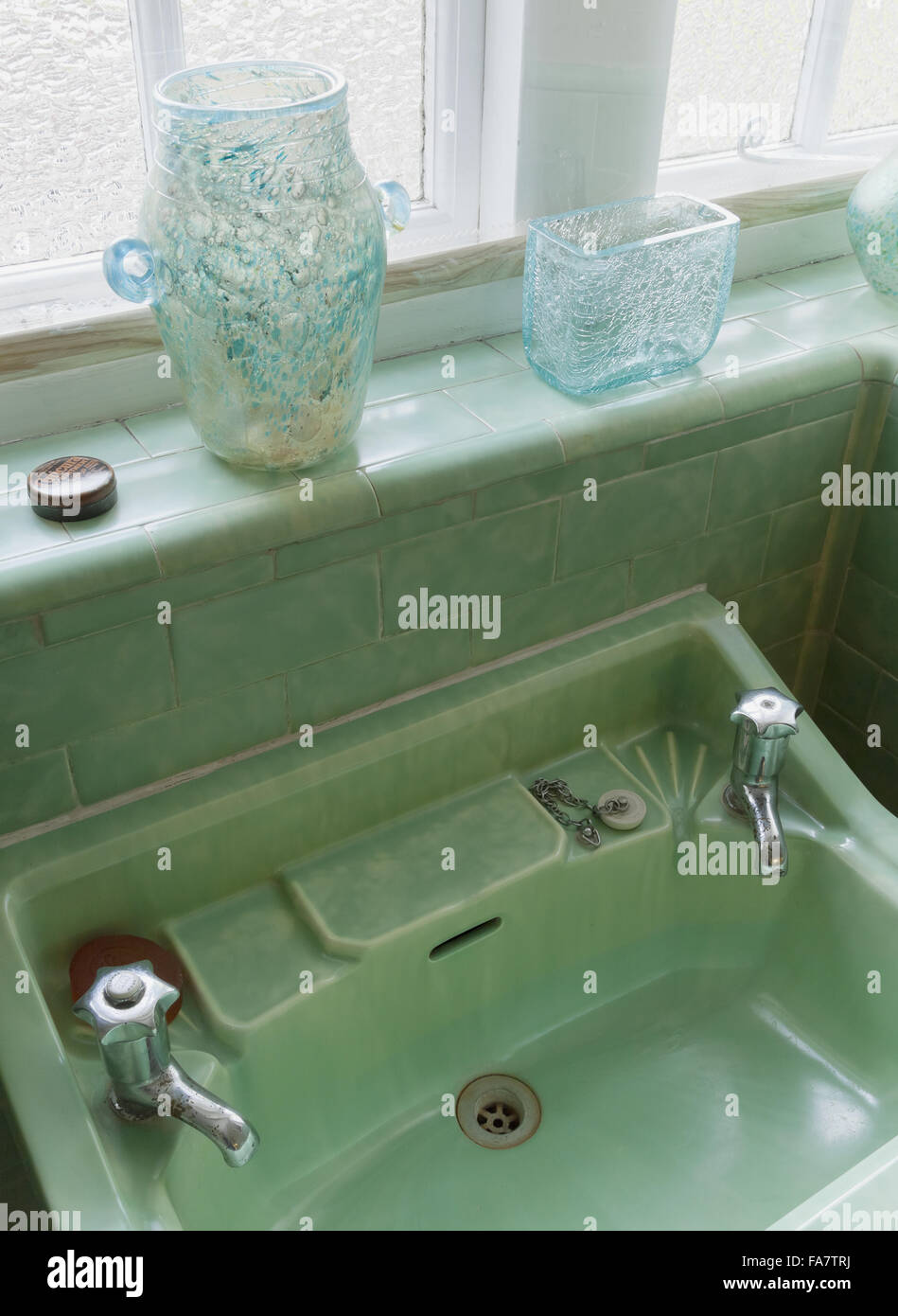 Wash basin in the Green Bathroom at Nuffield Place, Oxfordshire. The ...