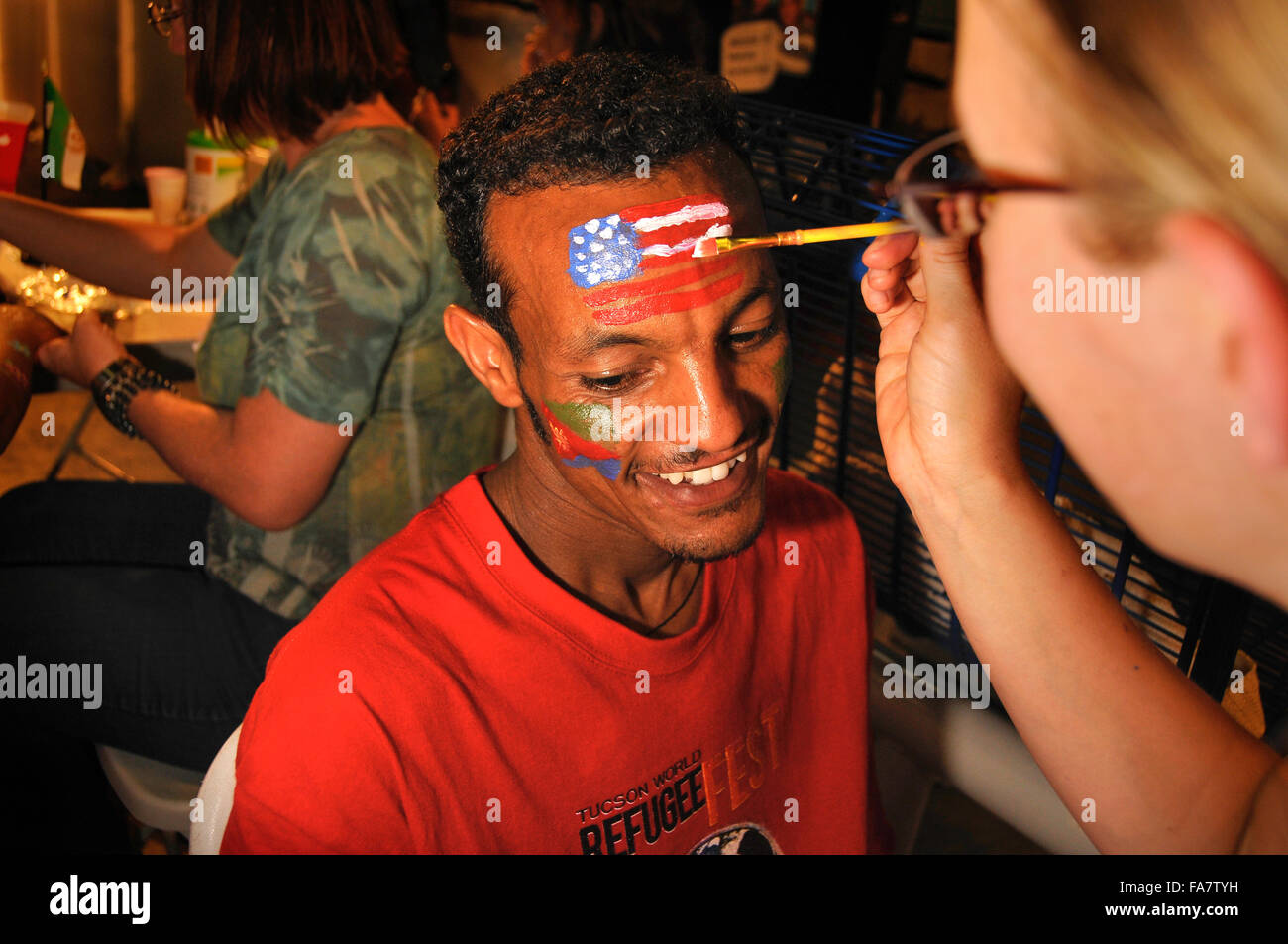Refugees celebrate at Tucson World Refugee Fest 2012, where some received their U.S. citizenship papers in Tucson, - Stock Image