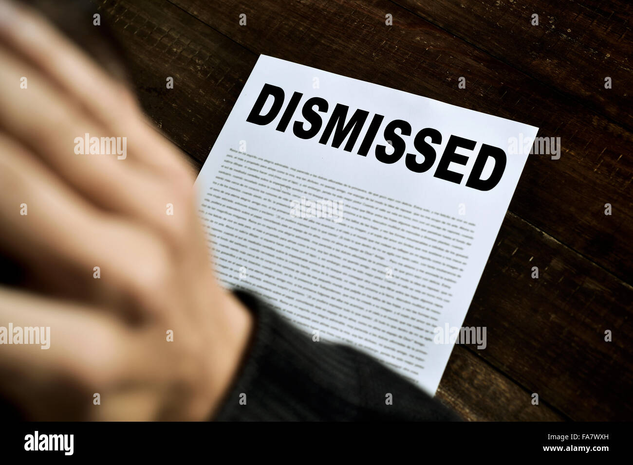 a young caucasian man with his hands in his head concerned because has been  dismissed - Stock Image