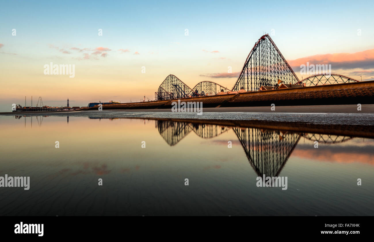 South Beach Blackpool with Pleasure Beach & roller coaster reflecting in pool of water - Stock Image