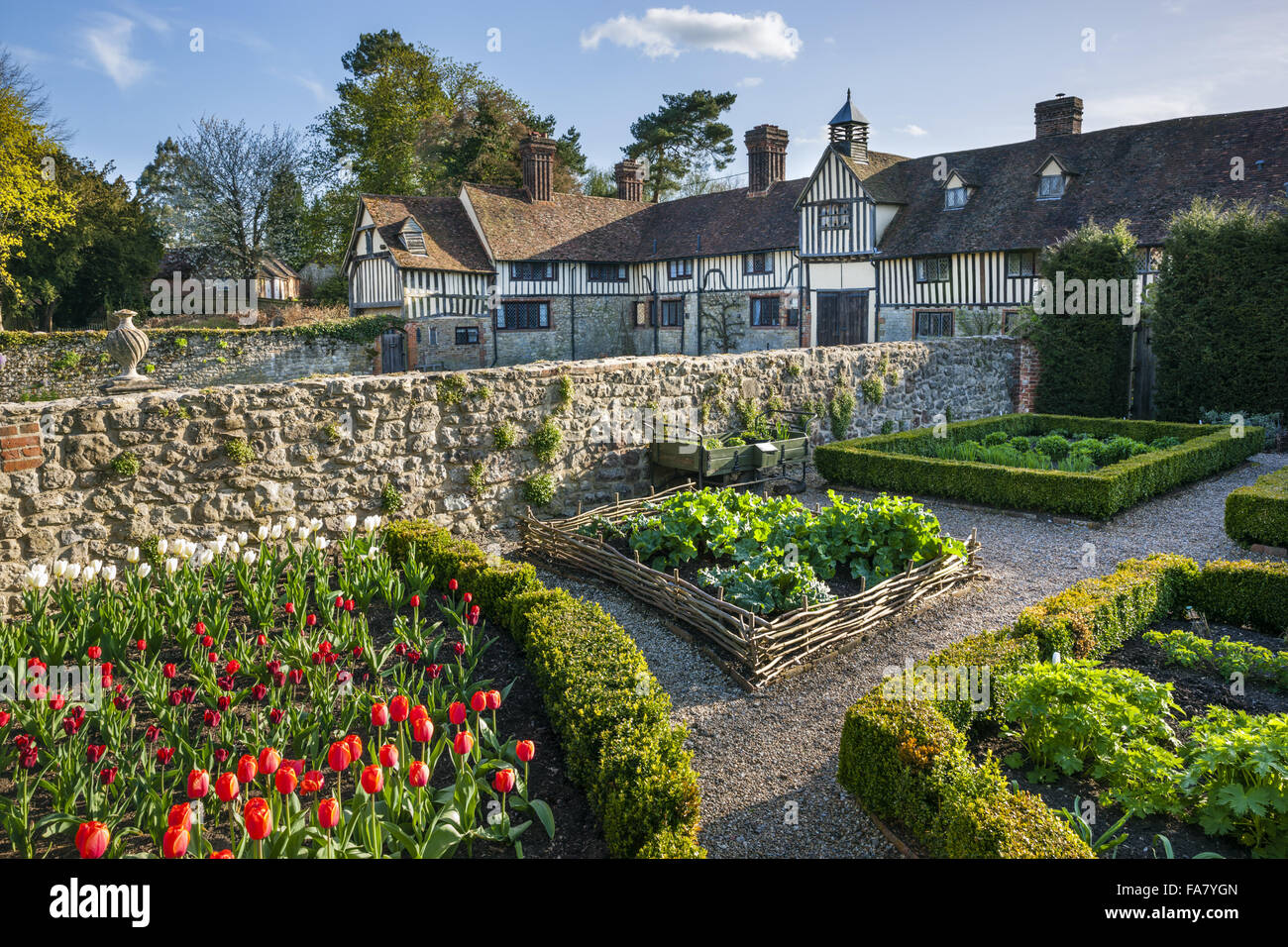 The flower and vegetable garden with the cottages in the background at Ightham Mote, Kent Stock Photo