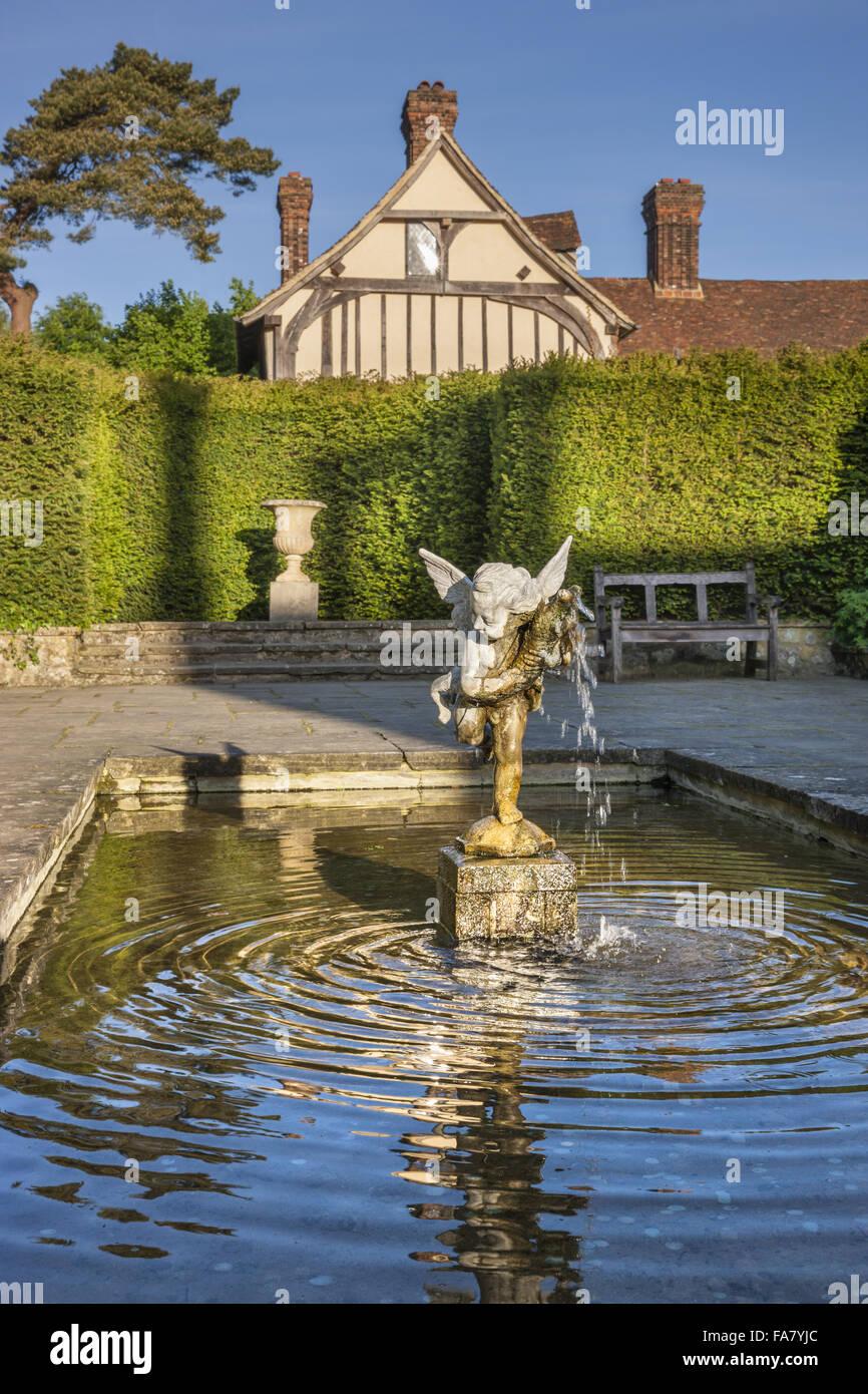 Cherub fountain in the garden at Ightham Mote, Kent Stock Photo