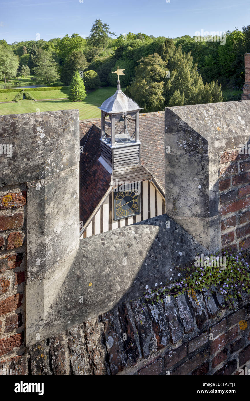 The clock and garden viewed from the tower at Ightham Mote, Kent - Stock Image