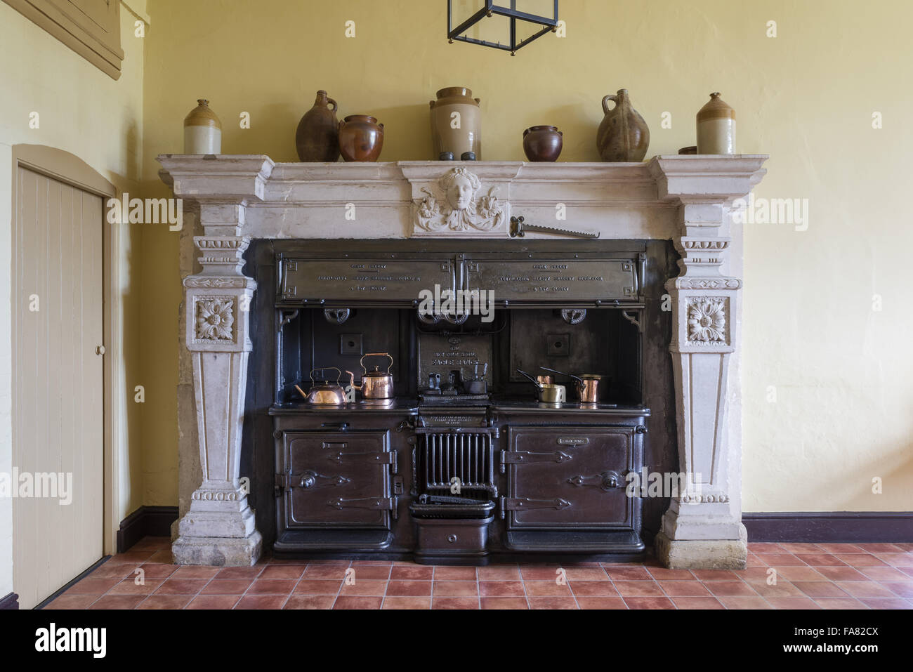 Victorian kitchen range set into an 18th-century chimneypiece, Oxburgh Hall, Norfolk. Formerly Oxburgh's kitchen, - Stock Image