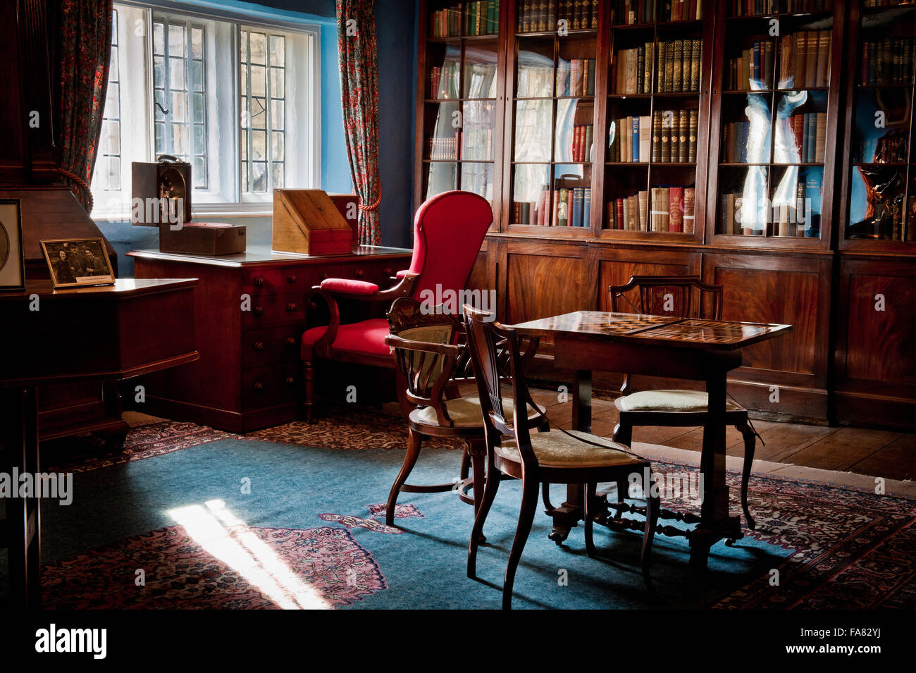 The Library at Eyam Hall, Derbyshire. Famously, when the plague was discovered in Eyam in 1665, the villagers decided Stock Photo