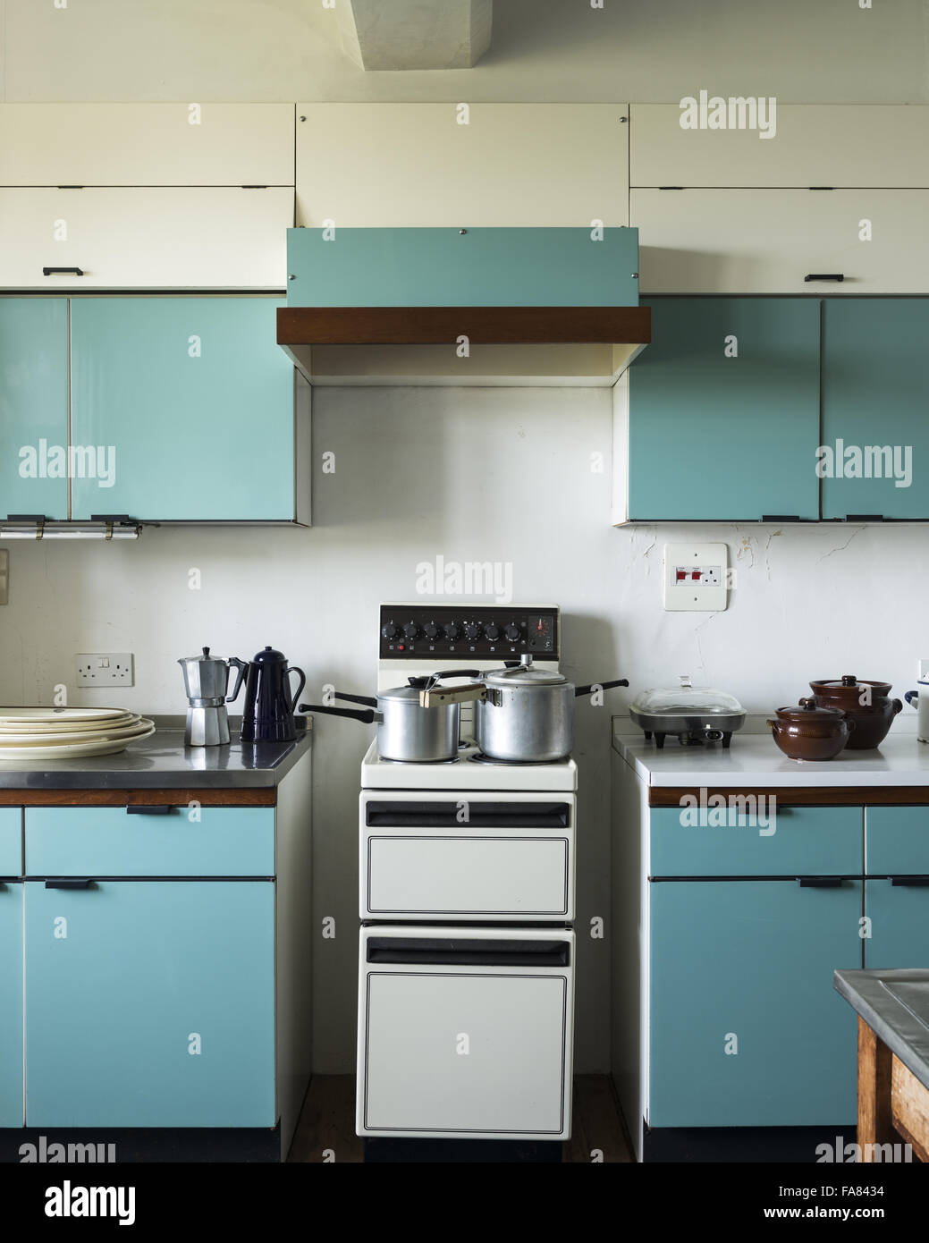 The blue kitchen at dunster castle somerset with electric cooker and blue 1950s kitchen