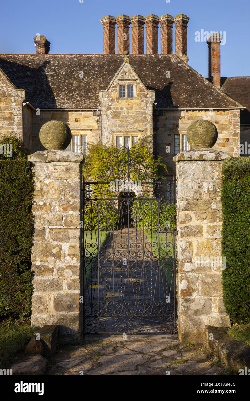 The east front Bateman's, East Sussex, shown through the garden gate. Bateman's was the home of the writer - Stock Image