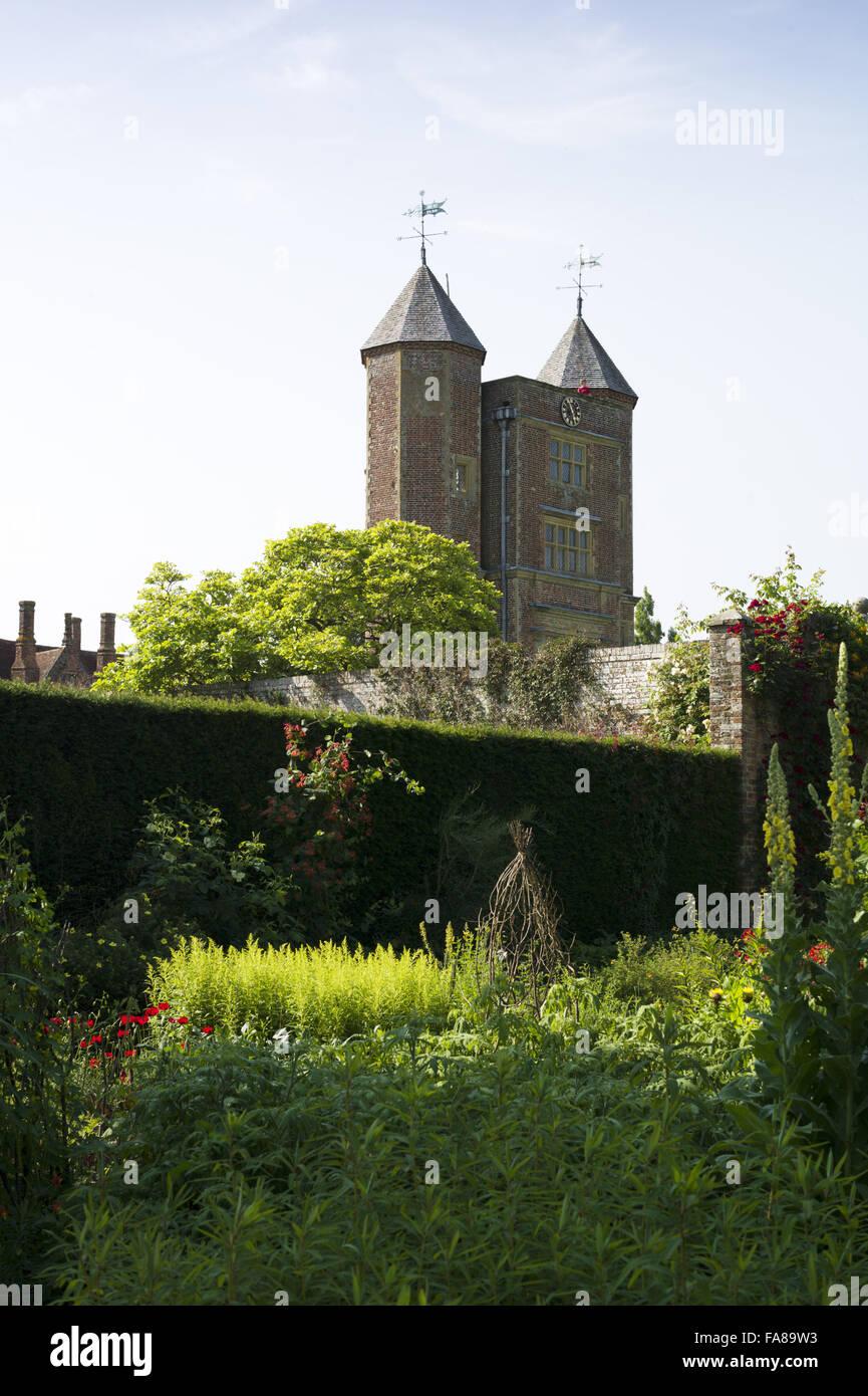 The Tower seen from the gardens in July at Sissinghurst Castle, Kent. Sissinghurst gained international fame in - Stock Image