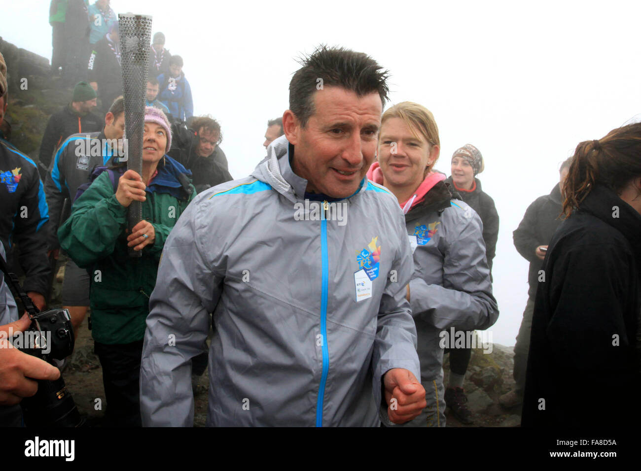 Sebastian Coe joins Scouts from the Snowdonia area  in lighting the Paralympic flame at the summit of Snowdon - Stock Image