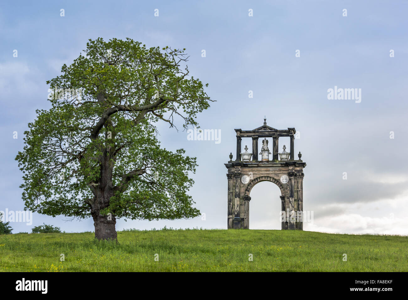 Triumphal Arch in June on the Shugborough Estate, Staffordshire. This is a copy of the Arch of Hadrian in Athens - Stock Image