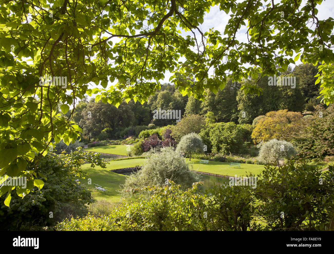 View towards the pond in the garden at Dyrham Park, Gloucestershire. - Stock Image