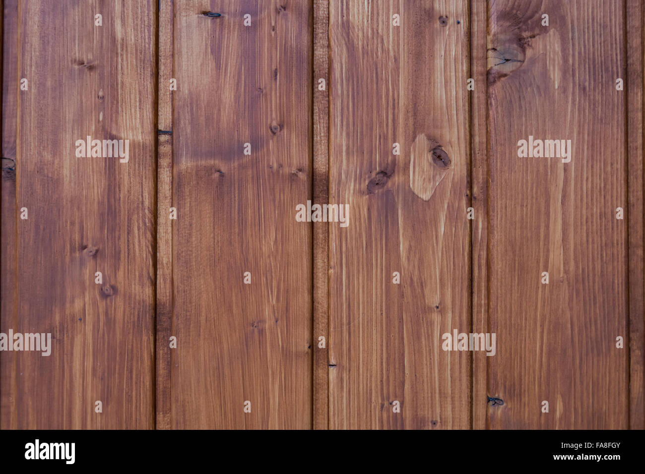 Texture, background, pattern or wallpaper of dark vertical wood planks - Stock Image