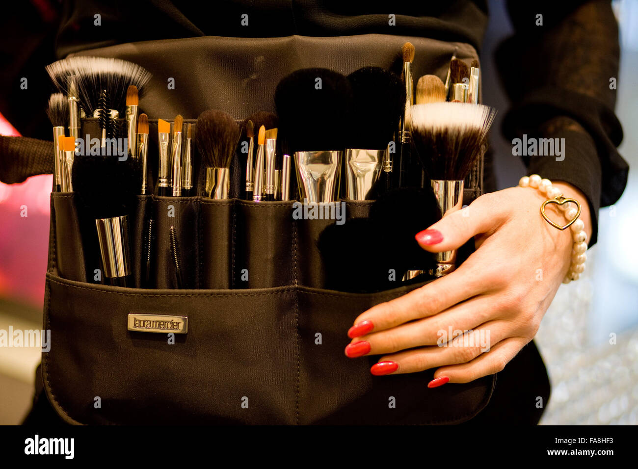makeup brushes in a belt - Stock Image