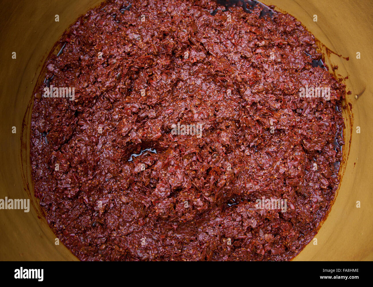 Pixian chilli bean paste maturing in earthenware vats in a yard in Chengdu in Sichuan in China. - Stock Image