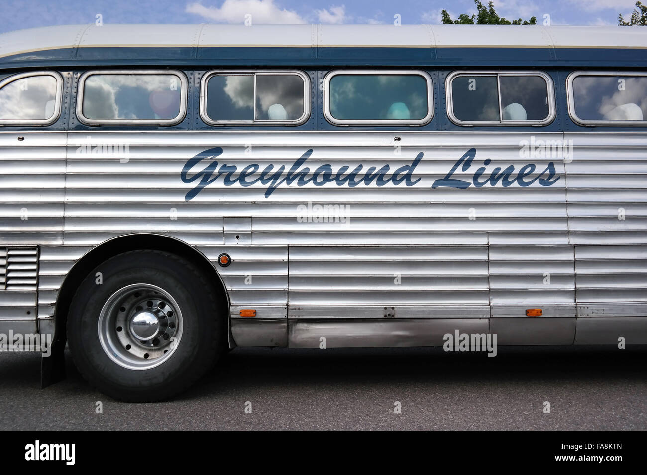 Side detail of an oldtimer Bus of Greyhound Lines. - Stock Image