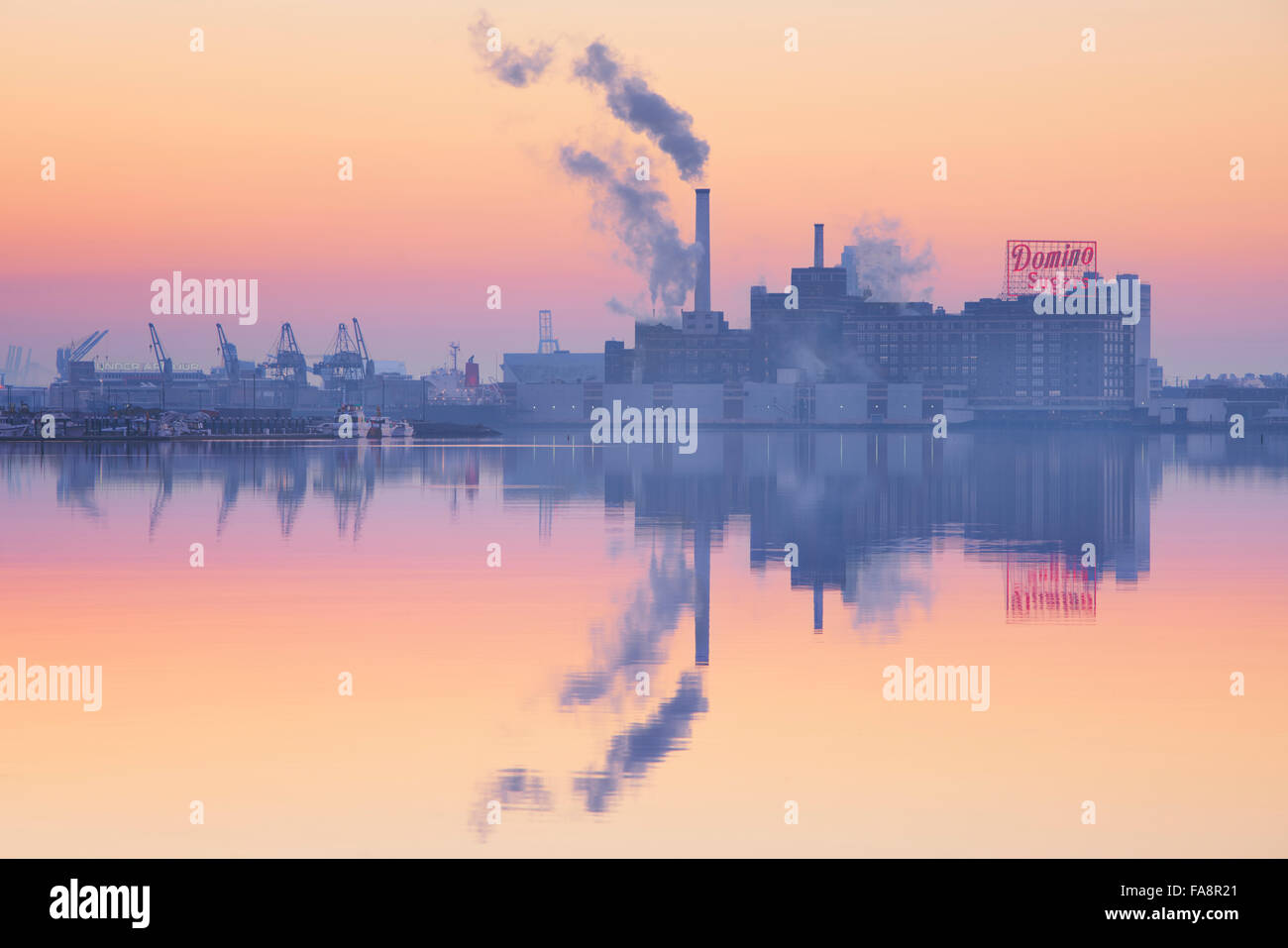 Early morning twilight over the Domino Sugars plant in Baltimore, Maryland - Stock Image