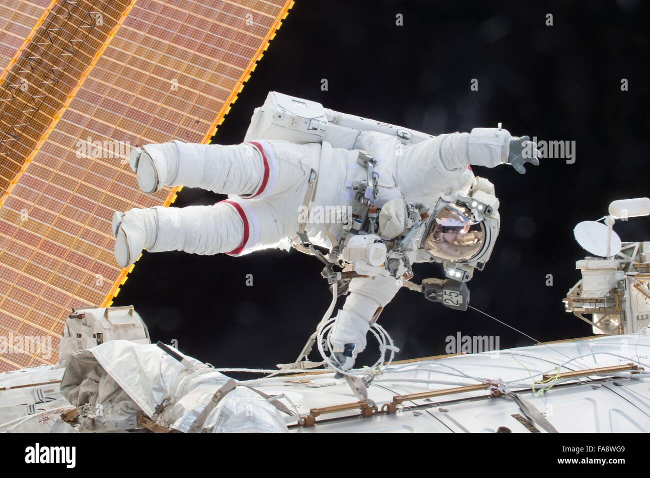 American astronaut Tim Kopra during a 3-hour space walk outside the International Space Station December 21, 2015 - Stock Image
