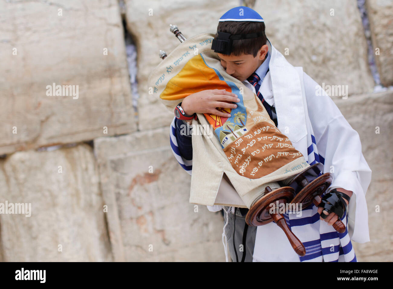 A young Jewish boy celebrates his Bar Mitzvah at the Western Wall also known as the Wailing Wall in Jerusalem, Israel. - Stock Image