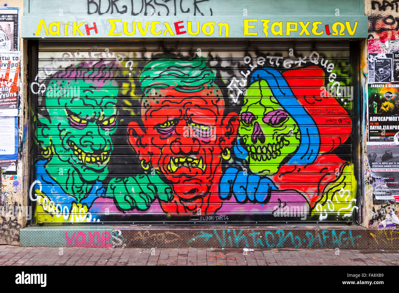 Commercial graffiti shop front on the door shutters of a shop in the Exarcheia area of Athens, Greece - Stock Image