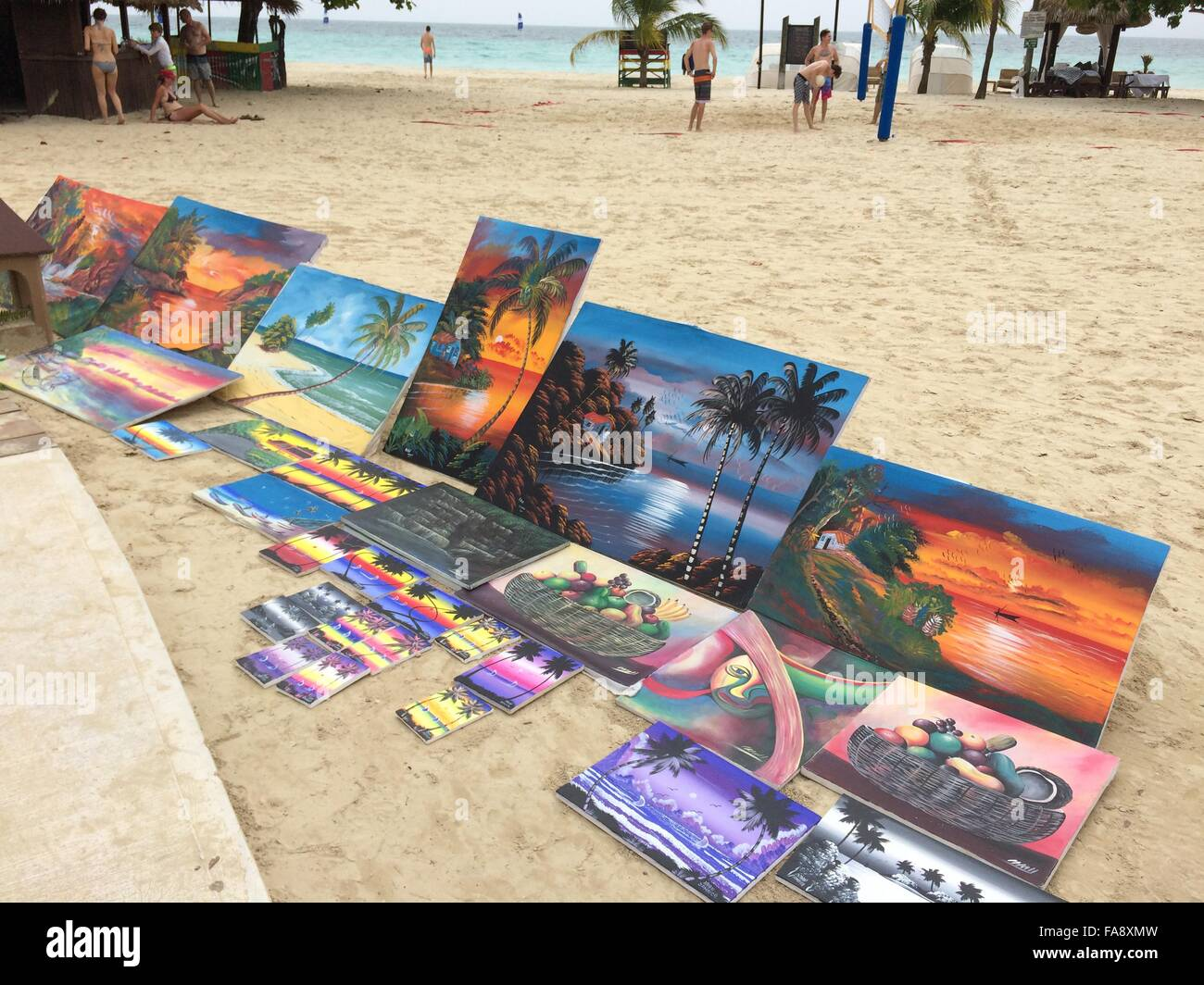 Paintings displayed on Seven Mile Beach in Negril, Jamaica - Stock Image