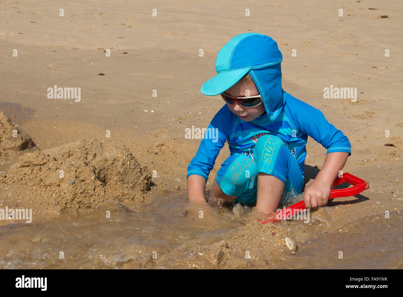 Boy playing on the beach at Praia De Santa Eulalia, near Albufeira, Algarve, Portugal Stock Photo