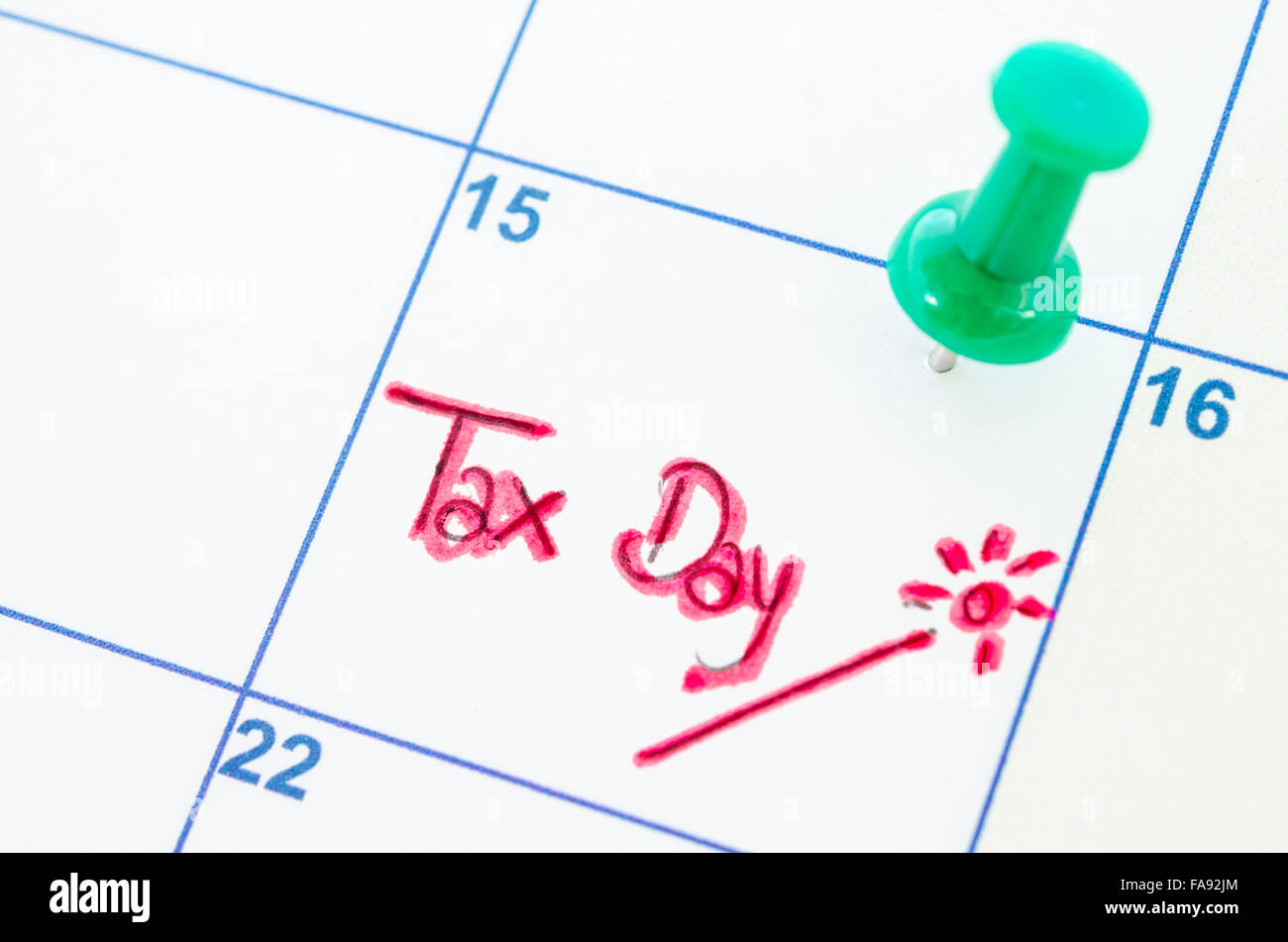 Tax day wording on calendar. - Stock Image