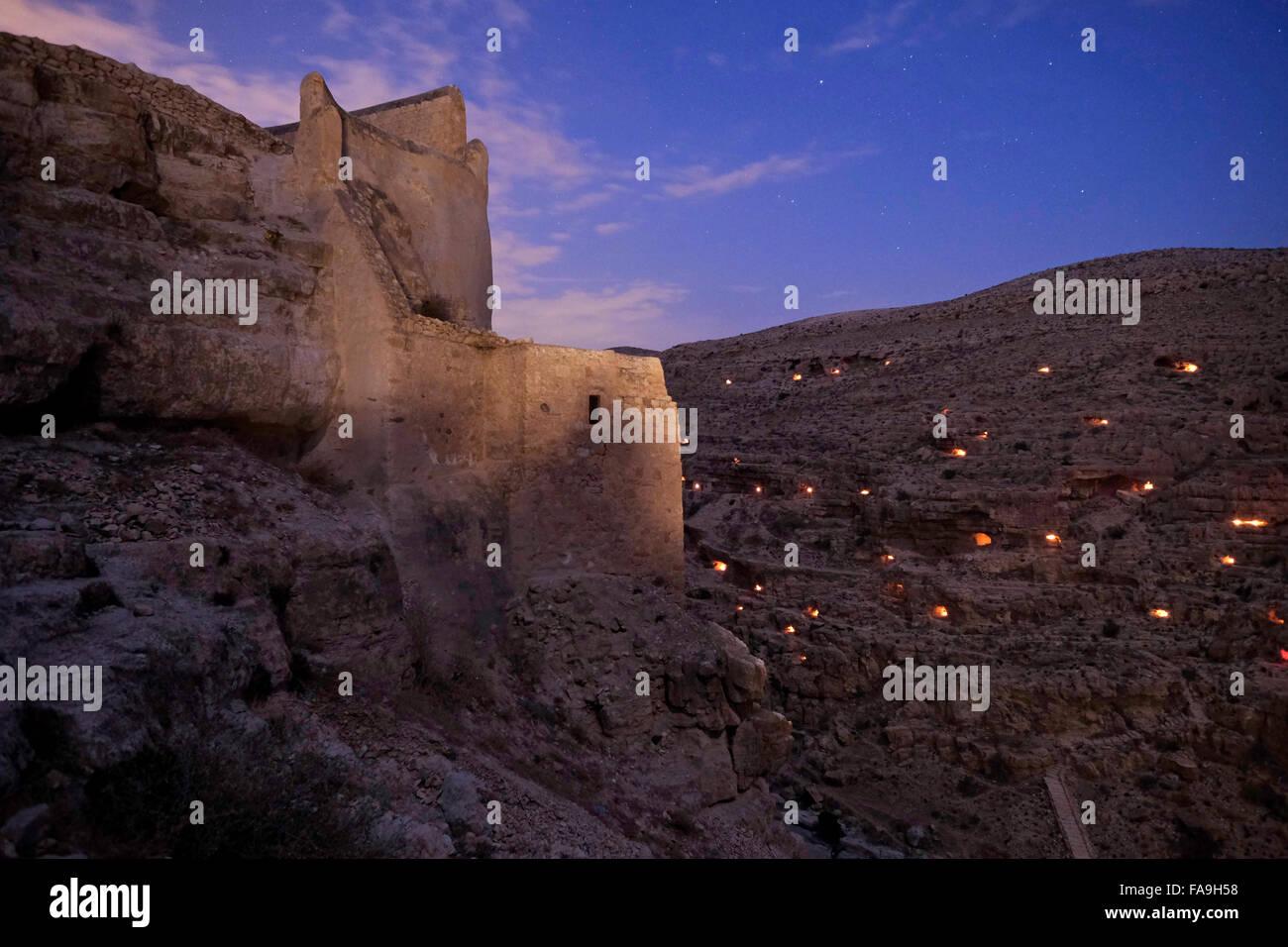 Light candles illuminating small caves near Mar Saba Monastery during Mar Saba Day in the Judaean or Judean desert - Stock Image