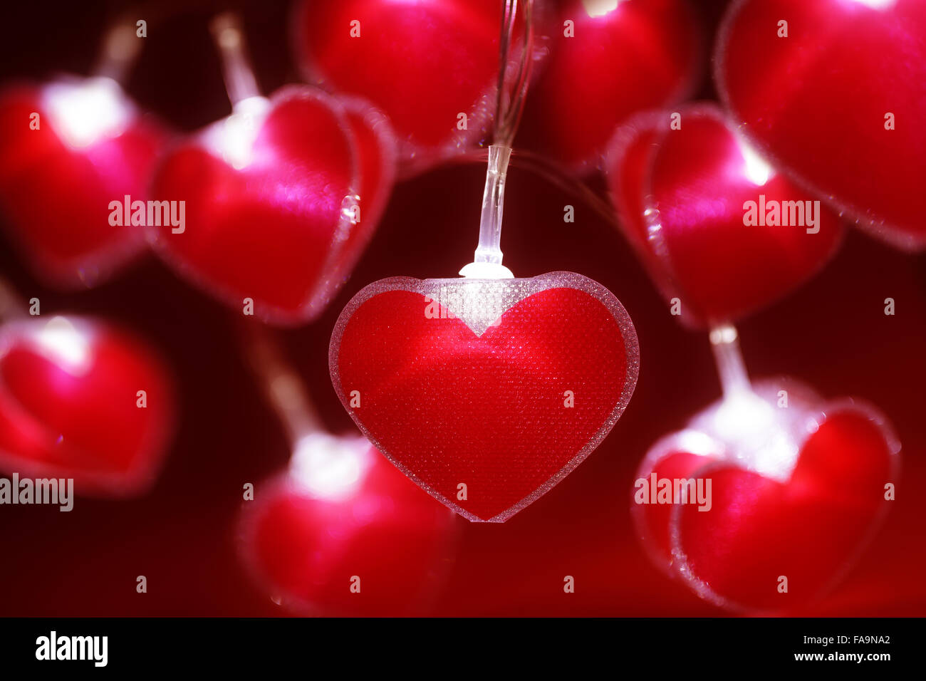 Red heart fairy lights Valentine's day background - Stock Image