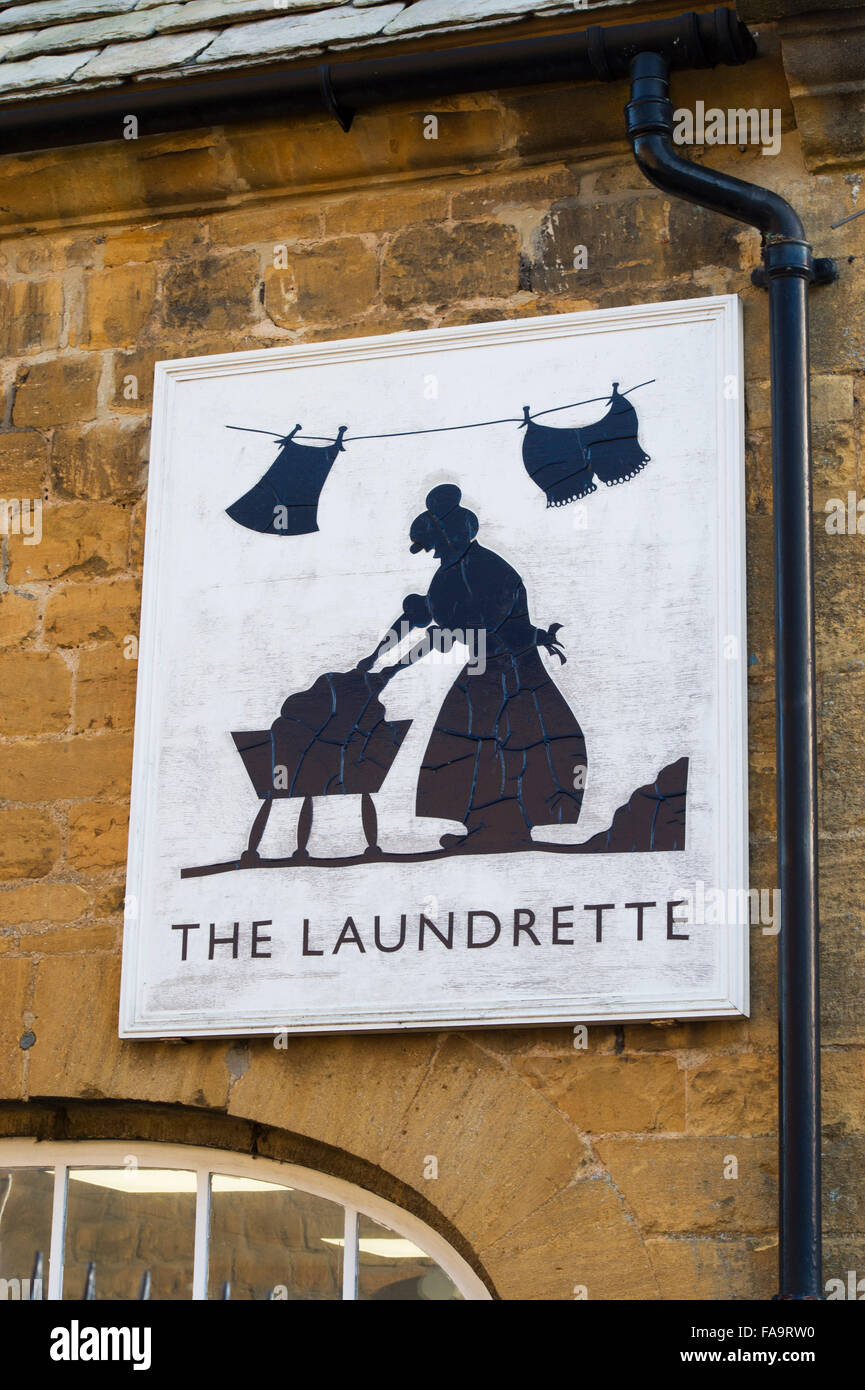 Quirky laundrette sign. Moreton in Marsh, Cotswolds, England - Stock Image