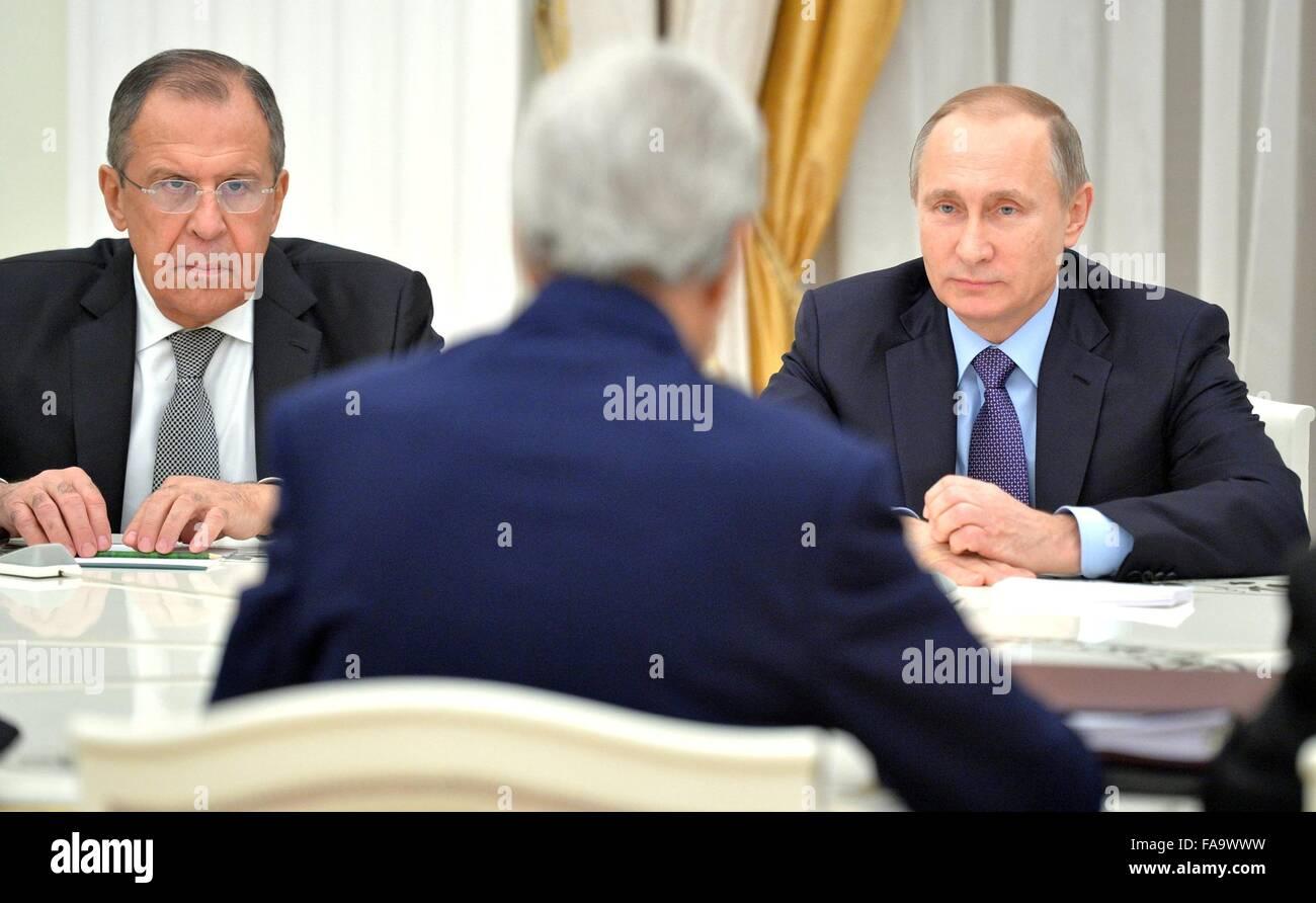 Russian President Vladimir Putin and Foreign Minister Sergei Lavrov listen to U.S Secretary of State John Kerry - Stock Image
