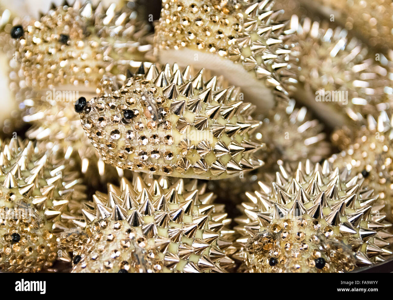 Background formed by golden hedgehogs to use as a paperweight. - Stock Image