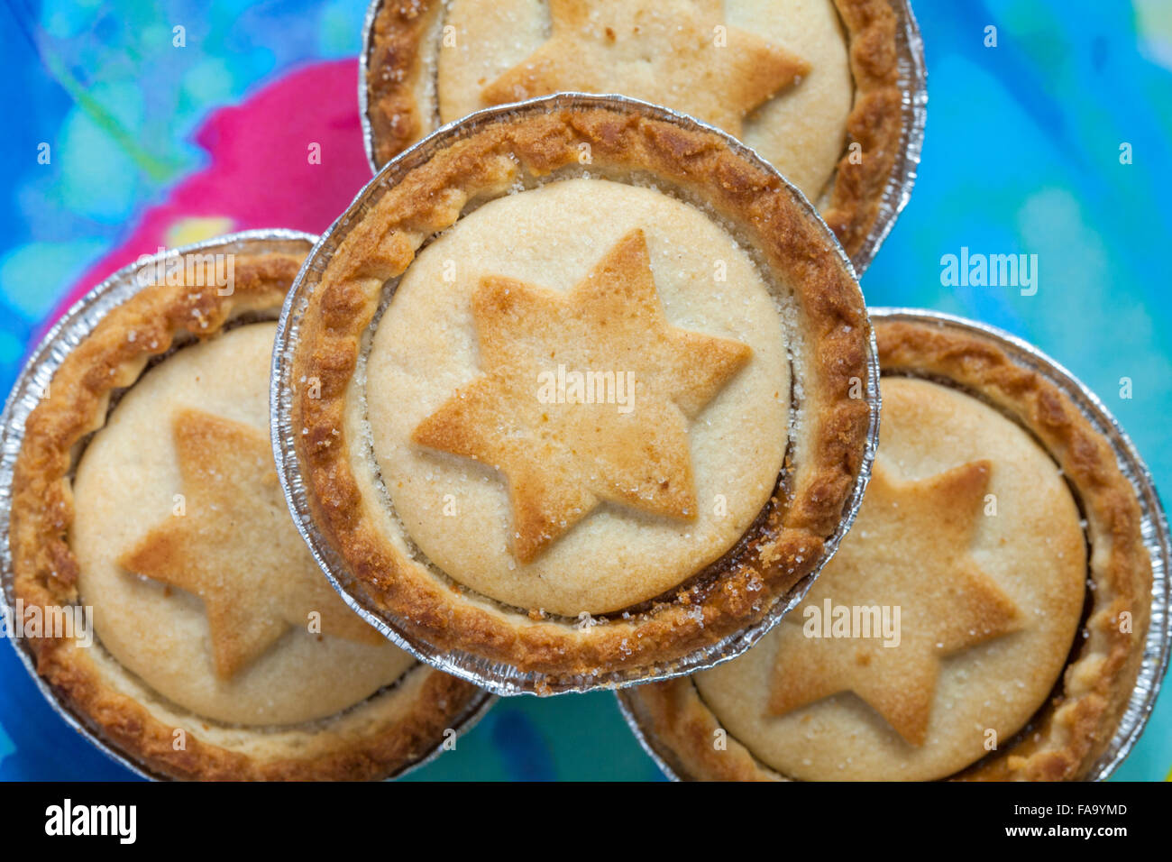 close up of mince pies with stars on, on plate ready for Christmas - Stock Image