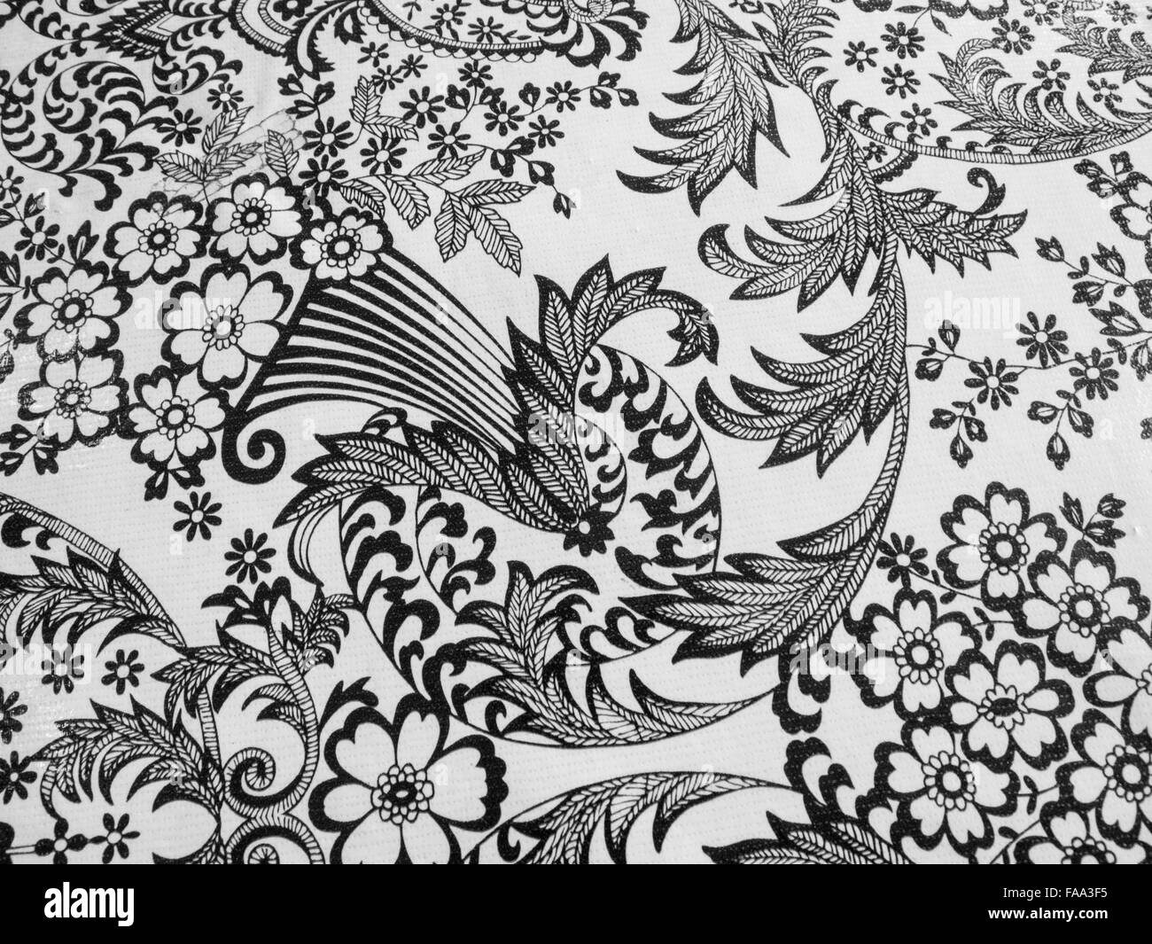 Close up of black and white tablecloth design - Stock Image