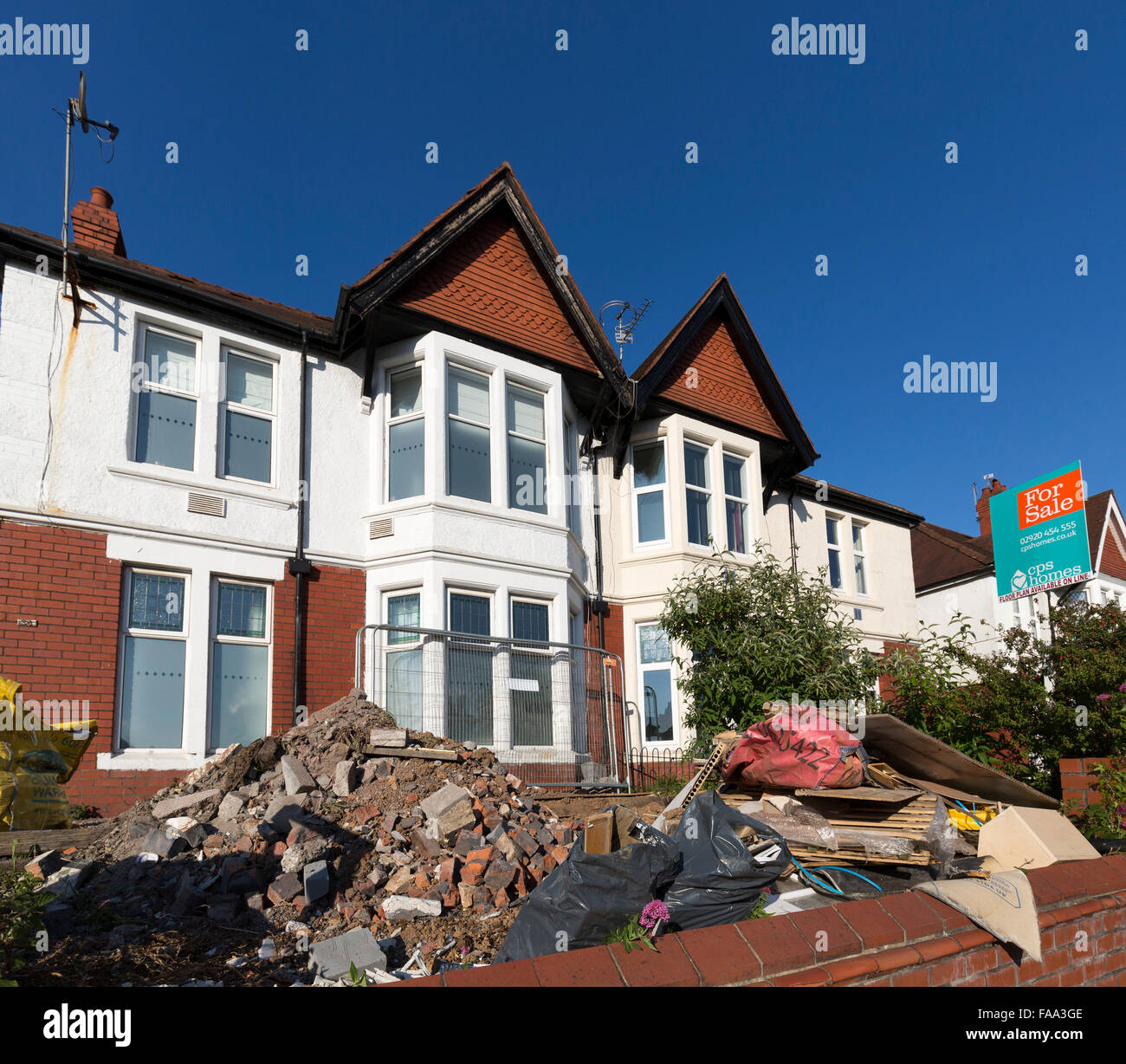 Building rubble from renovation in garden in front of house, Cardiff, Wales, UK - Stock Image