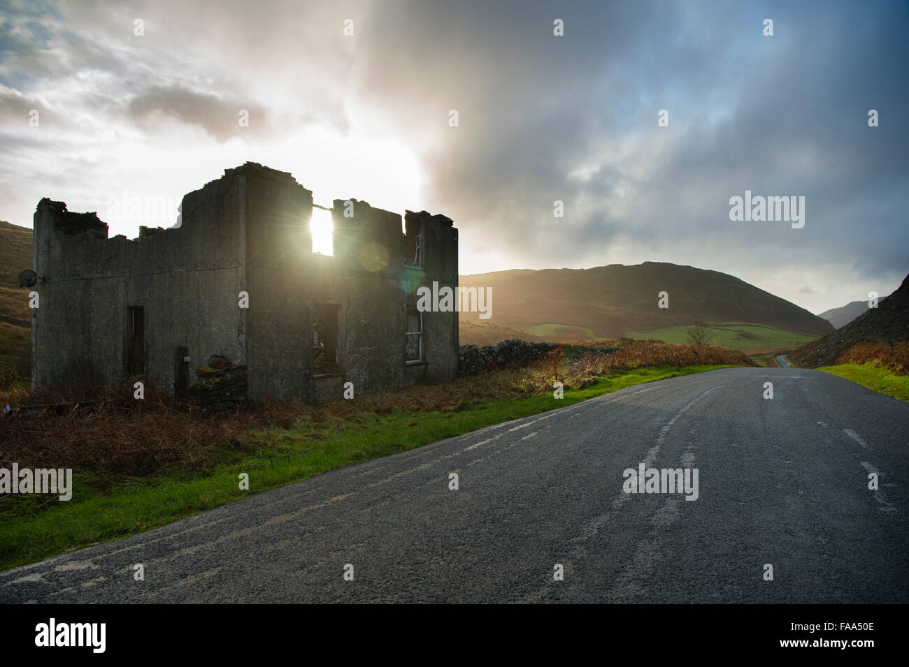 The broken shell of an abandoned and ruined house, in a remote valley in Gwynedd, Wales UK - Stock Image