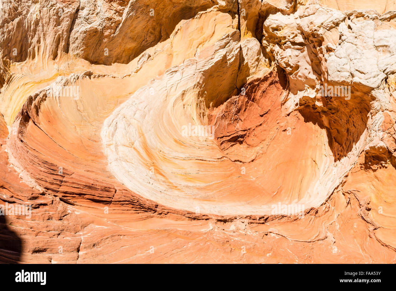 A rock formation gives the illusion of a giant palette of oil paint in the unique and remote White Pocket rock formations - Stock Image