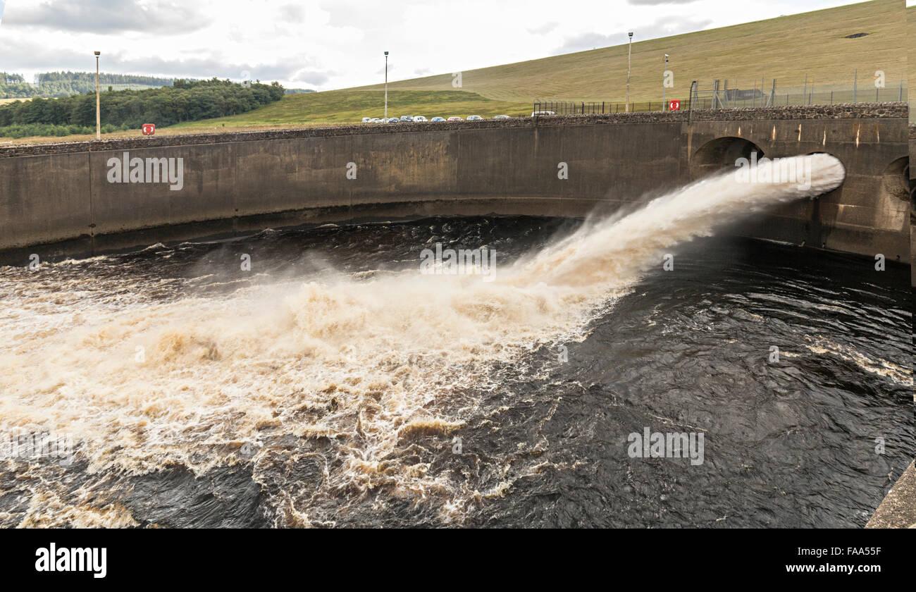 Discharge from dam, Kielder reservoir, Northumberland, England, UK - Stock Image