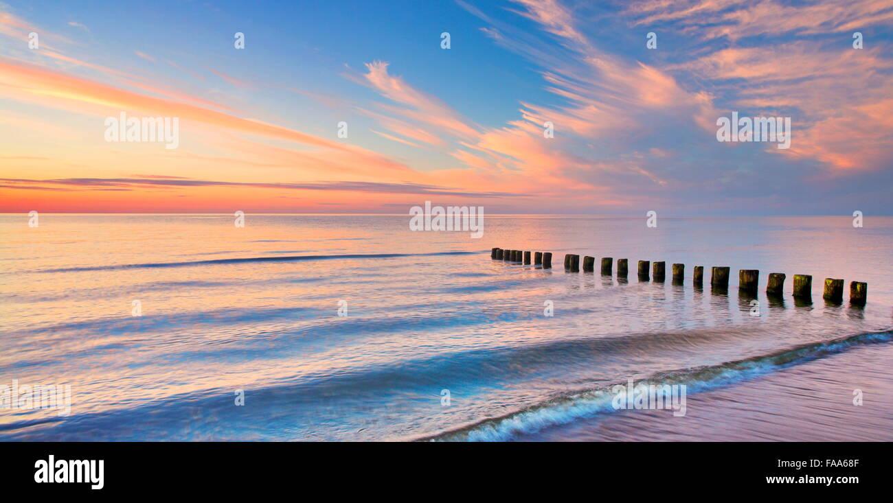 The Baltic beach sea at sunset, Pomerania, Poland - Stock Image